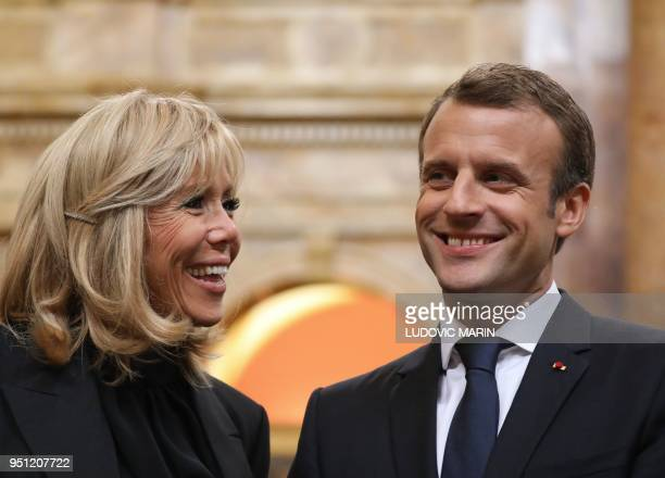 France's President Emmanuel Macron and his wife Brigitte Macron visit the Library of Congress prior to addressing a joint meeting of Congress on...