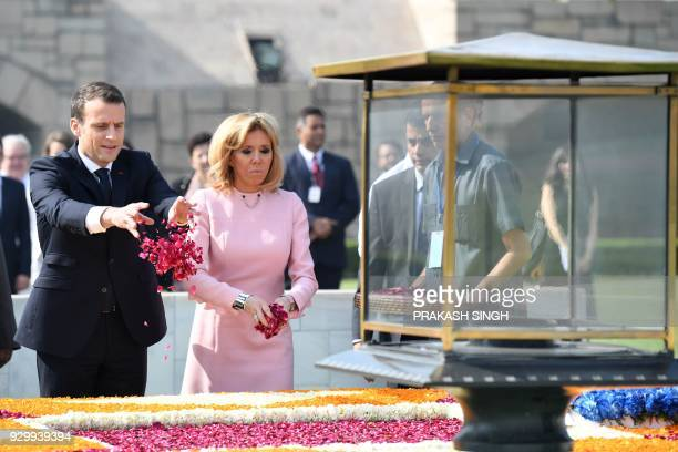 TOPSHOT France's President Emmanuel Macron and his wife Brigitte offer tributes at Rajghat memorial for Mahatma Gandhi in New Delhi on March 10 2018...