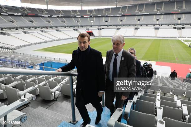 France's president Emmanuel Macron and Plaine Commune territorial organisation president Patrick Braouezec arrive for a visit for the inauguration of...