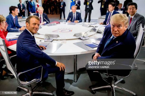 TOPSHOT France's President Emmanuel Macron and US President Donald Trump attend a working session on International Economy and Trade and...