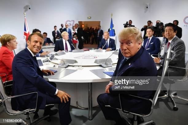 France's President Emmanuel Macron and US President Donald Trump pose for the media as they meet for the first working session of the G7 Summit on...