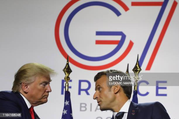 France's President Emmanuel Macron and US President Donald Trump shake hands during a joint-press conference in Biarritz, south-west France on August...