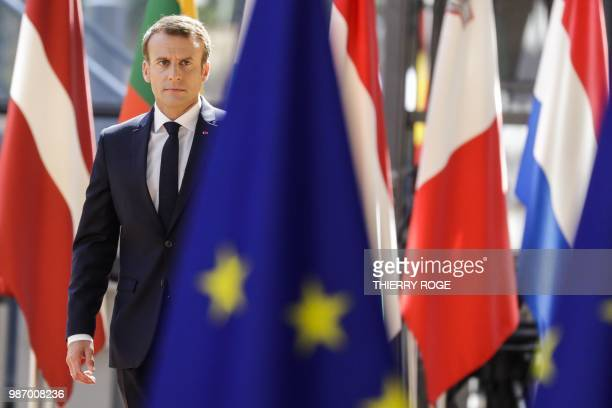 TOPSHOT France's President Emmanuel Macron arrives to take part in the last day of the European Union leaders' summit without Britain to discuss...