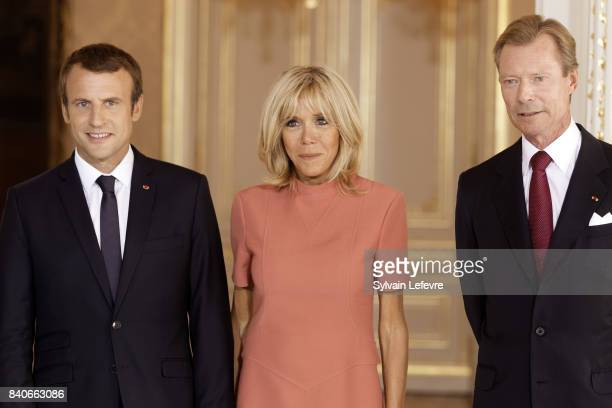 France's President Emmanuel Macron Brigitte MacronTrogneux France's first lady Grand Duke Henri of Luxembourg pose for official photo during a one...