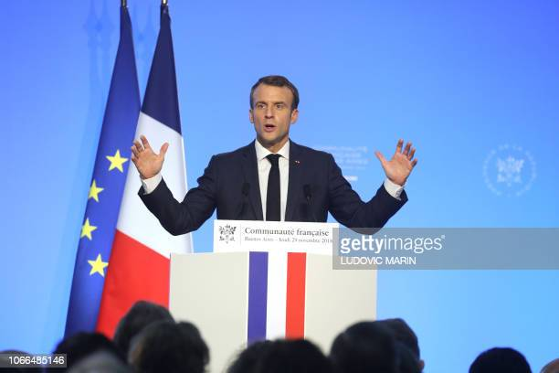 France's President Emmanuel Macron delivers a speech during a meeting with the French Community at the Usina del Arte in Buenos Aires on November 29...