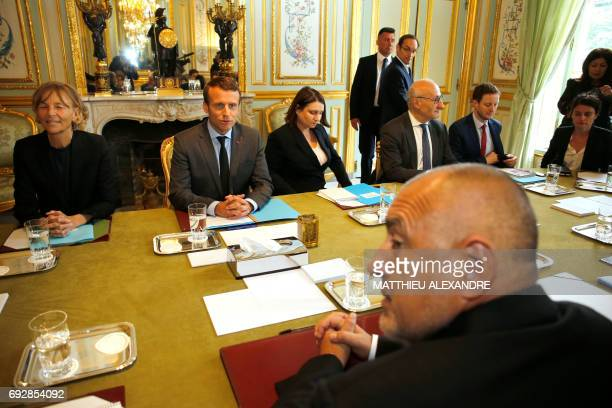 France's President Emmanuel Macron flanked by French Minister of European Affairs Marielle de Sarnez speaks with Bulgaria's new Prime Minister Boiko...