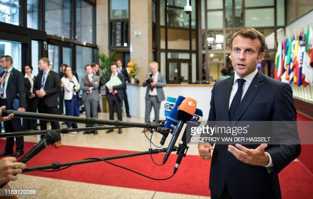 France's President Emmanuel Macron gestures as he speaks to the press at the end of an EU summit at the Europa building in Brussels on July 1 2019...