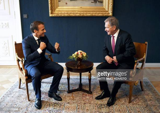 TOPSHOT France's President Emmanuel Macron gestures as he speaks with Finland's President Sauli Niinistö during a meeting in Helsinki on August 30...