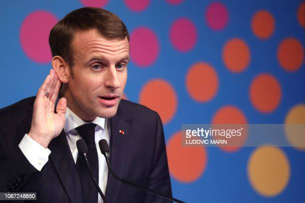 France's President Emmanuel Macron gestures during final press conference on the second day of the G20 Leader's Summit in Buenos Aires on December 01...