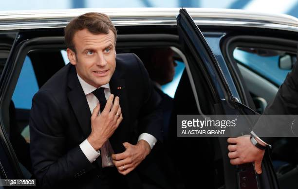 France's President Emmanuel Macron gets out of his car as he arrives ahead of a European Council meeting on Brexit at The Europa Building at The...