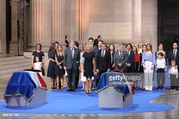 France's President Emmanuel Macron his wife Brigitte Macron the sons of late French politician and Holocaust survivor Simone Veil and her husband...