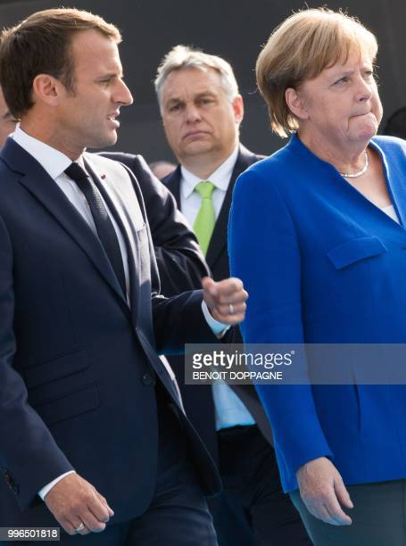 France's President Emmanuel Macron Hungary Prime Minister Viktor Orban and Chancellor of Germany Angela Merkel arrive for a working dinner at The...