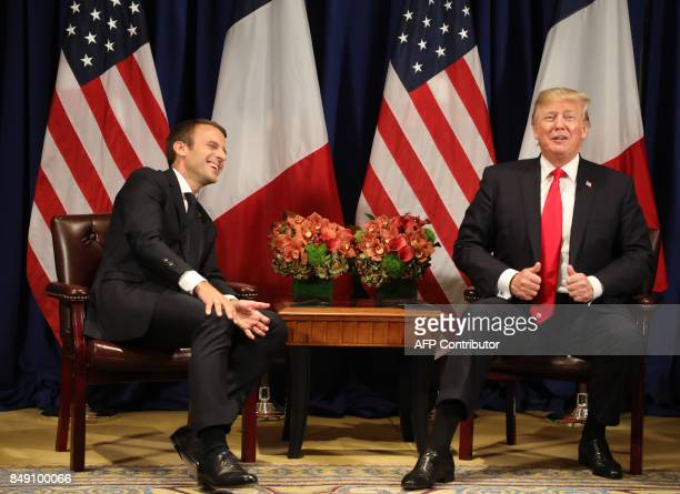 France's president Emmanuel Macron laughs with US President Donald Trump before a meeting at the Palace Hotel during the 72nd session of the United...