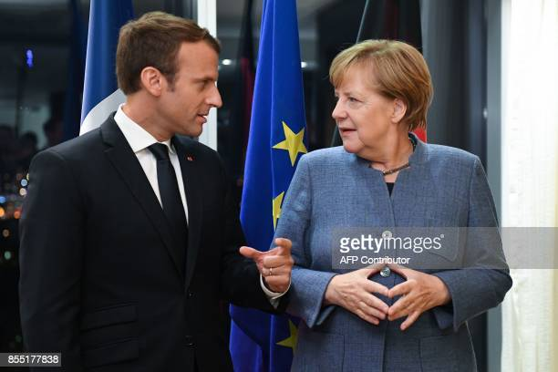 France's President Emmanuel Macron meets with Germany's Chancellor Angela Merkel on the eve of the European Union Digital Summit in Tallinn on...