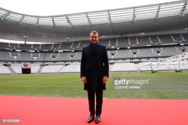 France's president Emmanuel Macron poses during a visit to the Stade de France to attend the inauguration of the Olympic Committee site for the Paris...
