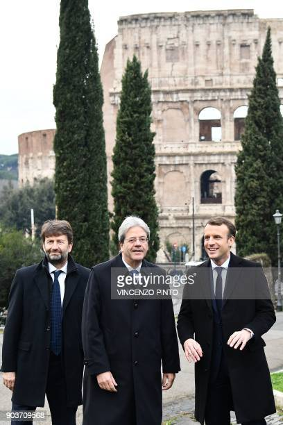 France's President Emmanuel Macron poses with Italy's Cultural Heritage and Activities Minister Dario Franceschini and Italy's Prime Minister Paolo...