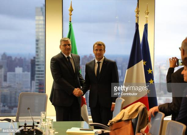 France's President Emmanuel Macron shakes hands with chief negotiator for the Syrian opposition Riyad Hijab at the French mission at the United...
