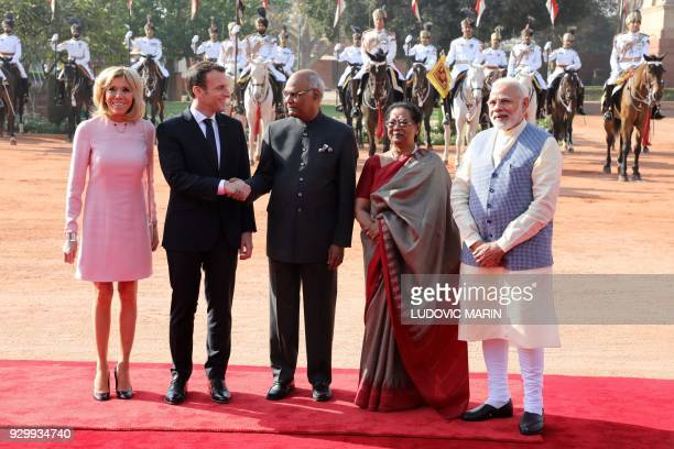 TOPSHOT France's President Emmanuel Macron shakes hands with India's President Ram Nath Kovind as Macron's wife Brigitte Kovind's wife Savita and...