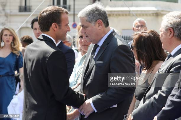 France's President Emmanuel Macron shakes hands with the son of late French politician and Holocaust survivor Simone Veil PierreFrancois Veil and his...