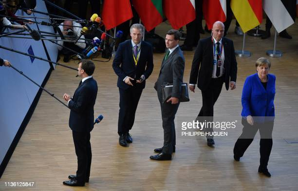 France's President Emmanuel Macron speaks to the press as Germany's Chancellor Angela Merkel arrives ahead of a European Council meeting on Brexit at...