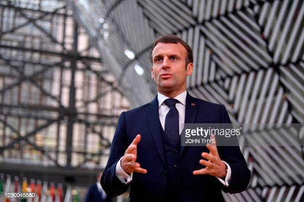 France's President Emmanuel Macron speaks to the press as he arrives at the EU headquarters' Europa building in Brussels on December 10 prior to a...