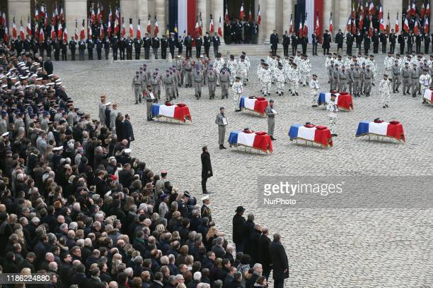 France's President Emmanuel Macron stands in front of coffins of the 13 French soldiers killed in Mali during a tribute ceremony on December 2, 2019...