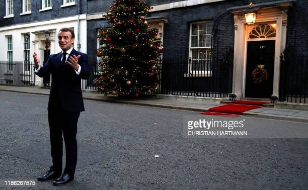 France's President Emmanuel Macron talks to the media as he arrives at 10 Downing Street, to talks with Britain's Prime Minister Boris Johnson, ahead...
