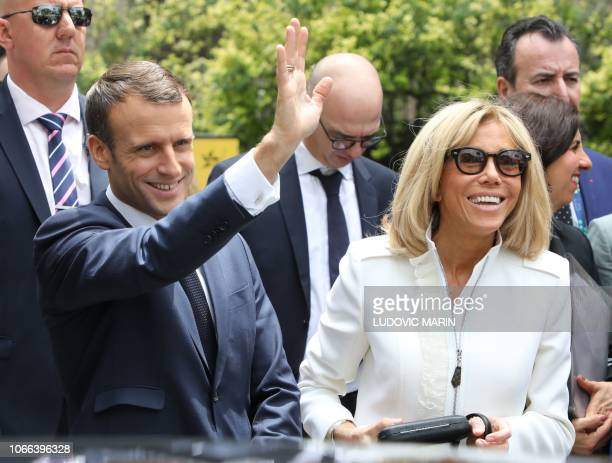 France's President Emmanuel Macron waves next to France's First Lady Brigitte Macron visit the Metropolitan Cathedral in Buenos Aires on November 29...