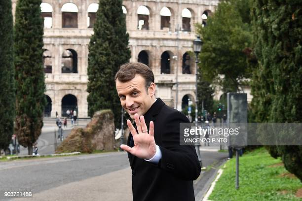 France's President Emmanuel Macron waves to photographers after a visit at the Domus Aurea the house built by Roman Emperor Nero on January 11 2018...