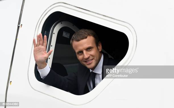 France's president Emmanuel Macron waves upon his arrival to Rennes on July 1 following the inauguration of a new TGV line between Paris and Rennes /...