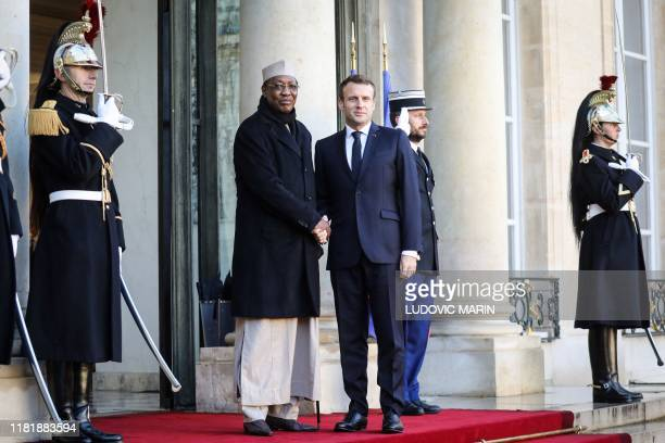 France's President Emmanuel Macron welcomes Chad's President Idriss Deby as he arrives at the Elysee presidential palace for a lunch as part of the...