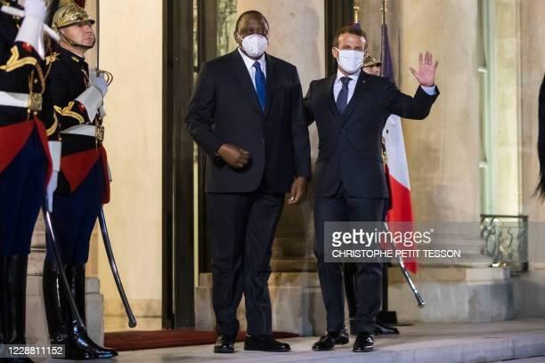 France's President Emmanuel Macron welcomes Kenya's President Uhuru Kenyatta before their meeting at the Elysee presidential Palace in Paris on...