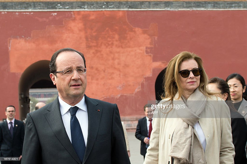 France's President Francois Hollande (L) and his partner Valerie Trierweiler (R) visit the Forbidden City as part of a two-day visit in Beijing on April 26, 2013. Hollande arrived in Beijing on April 25 for a two-day China trip aimed at boosting exports to China, with hopes that deals can be reached over the sale of aircraft and nuclear power.