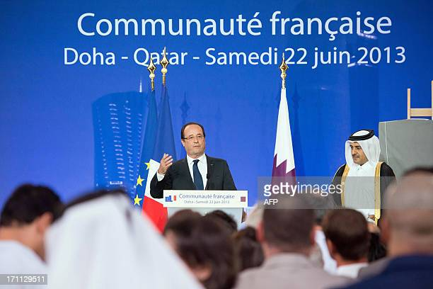 France's President Francois Hollande delivers a speech next to Qatar's Attorney General Ali bin Mohsen bin Fetais alMarri at the Voltaire...
