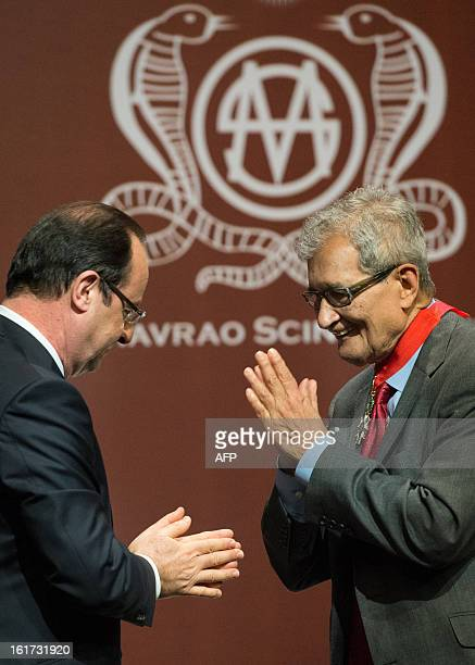 France's President Francois Hollande gestures torwards Nobel Prize award winner Indian Amartya Sen after giving him France's highest civilian award...
