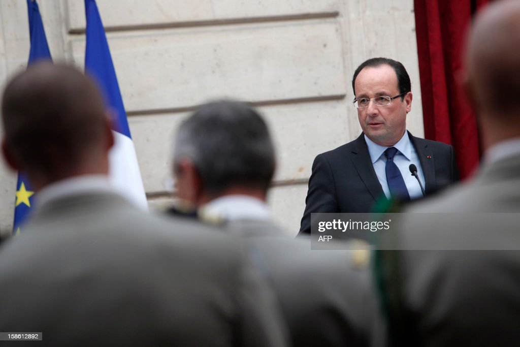 France's President Francois Hollande gives a speech during a ceremony in honour of French troops that served in Afghanistan, on December 21, 2012 at the Elysee Palace, in Paris. Hollande has declared 'mission accomplished' for French combat troops who returned home recently from Afghanistan. France still has 1,500 troops in Afghanistan repatriating equipment or working in roles like providing medical care or helping run Kabul's airport. Hollande said the numbers will decline to 500 by mid-2013.