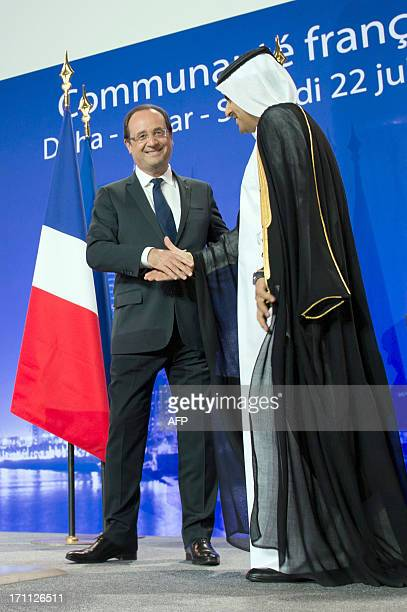 France's President Francois Hollande is congratulated by Qatar's Attorney General Ali bin Mohsen bin Fetais alMarri at the Voltaire QatariFrench...