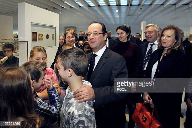 France's President Francois Hollande is seen with his companion Valerie Trierweiler during the inauguration of the Louvre-Lens Museum in the northern...