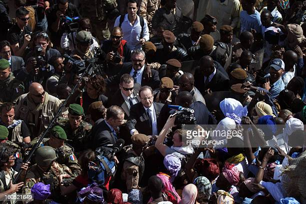 France's President Francois Hollande is welcomed by Malian people as he arrives at Timbuktu the second step of his oneday visit in Mali on February 2...