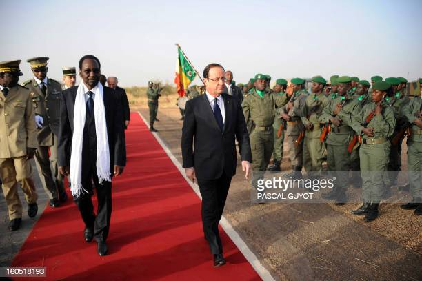 France's President Francois Hollande is welcomed by Mali's interim president Dioncounda Traore upon his arrival at Sevare near Mopti on February 2...