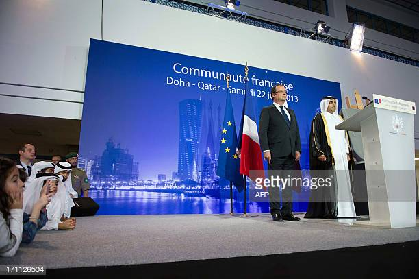 France's President Francois Hollande poses for a picture with Qatar's Attorney General Ali bin Mohsen bin Fetais alMarri at the Voltaire QatariFrench...