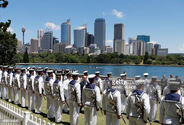 France's President Francois Hollande receives military honors during a welcoming ceremony at the Fleet Steps in Royal Botanic Gardens in Sydney on...