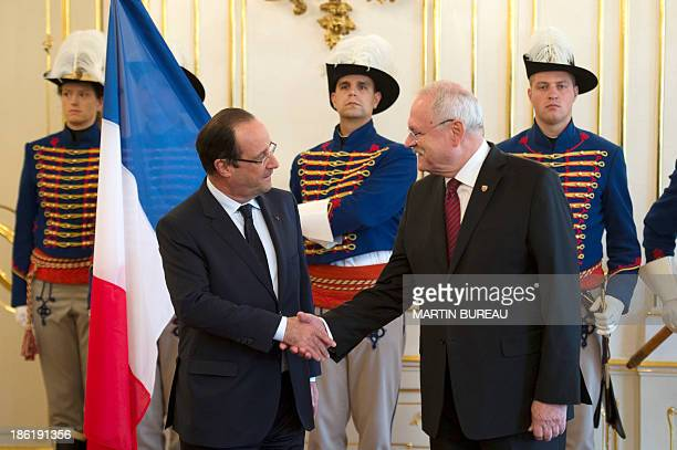 France's president Francois Hollande shakes hands with his Slovakian counterpart Ivan Gasparovic during his official visit to Slovakia, on October...
