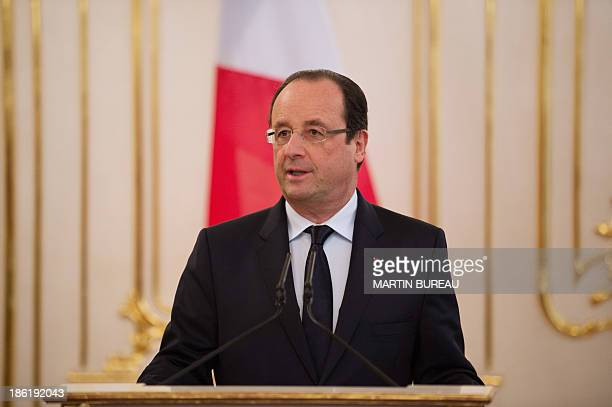 France's president Francois Hollande speaks alongside his Slovakian counterpart as they give a press conference after a meeting at the presidential...