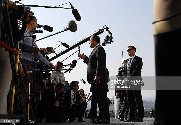 TOPSHOT France's President Francois Hollande speaks to media upon arrival for the informal EU summit at the Bratislava Castle in the Slovak capital...