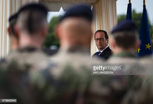France's President Francois Hollande speaks to soldiers of the antiterror Vigipirate plan dubbed 'Operation Sentinelle' at the fort of Vincennes on...