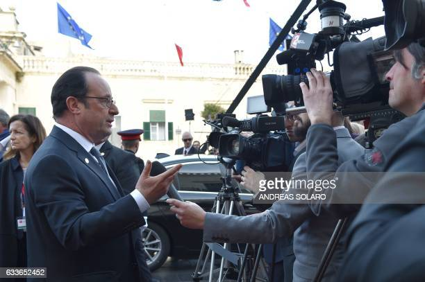 France's President Francois Hollande speaks to the press as he arrives at an Informal summit of EU heads of state or government on February 3 2017 in...