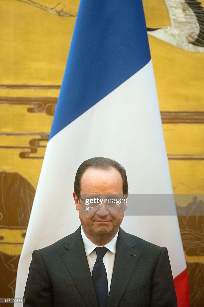 France's President Francois Hollande takes part in a signing contracts ceremony with his Chinese counterpart Xi Jinping (unseen) as part of a two-day visit of State at the Great Hall of the People in Beijing on April 25, 2013.