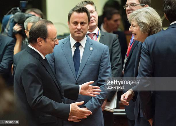 France's President Francois Hollande talks to Britain's Prime minister Theresa May as Luxembourg's Prime minister Xavier Bettel looks on during an...