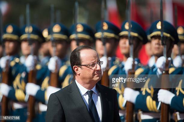 France's President Francois Hollande walks past an honour guard during a welcoming ceremony for the French leader outside the Great Hall of the...